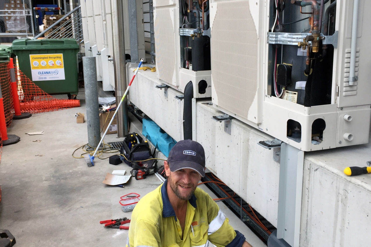 Edan Rayner-Sharp working diligently at the project installing DX refrigeration systems.